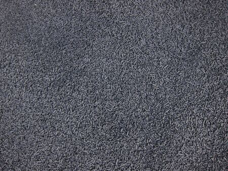 obtained: polymers of gray color obtained from processing waste Stock Photo