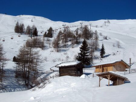 mountain landscape with snow and wooden houses