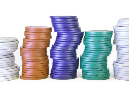 stack of different colored poker chips, stacked and isolated on white                                photo