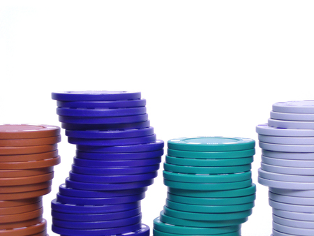stack of different colored poker chips, isolated on white                                photo