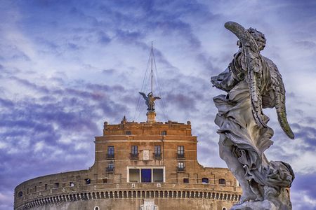 Statue on Castel Sant Angelo with clouds in blu sky, Rome Italy