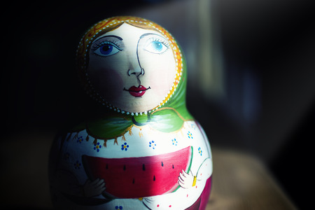 russian nesting dolls: Russian matryoshka with light spot, concept of tradition Russia Stock Photo