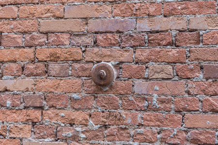 Construction technology. Iron support on a red brick wall.