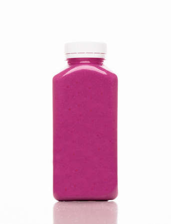 Cold-pressed violet blueberry and cranberry juice for detoxification on a white background. Juice made of organic fruits and vegetables. Clean nutrition, weight loss, healthy eating concept.