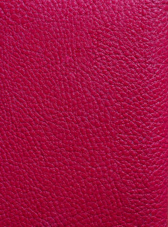 Red Leather Background. Red leather texture closeup background. Structured background design leather. A place for text or a logo. Beauty and Fashion. Red leather jacket.