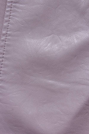 Pink Leather Background. Pink leather texture closeup background. Structured background design leather. A place for text or a logo. Beauty and Fashion. Pink leather jacket. 免版税图像
