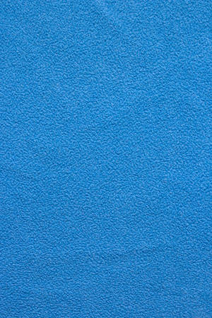 Background Blue Woolen Fabric. Blue flannel fabric texture background simple surface used backdrop or products design. Blue cloth background with fabric texture.