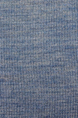 Blue natural texture of knitted wool textile material background. Blue cotton fabric woven canvas texture. Knitted realistic seamless background of blue color.