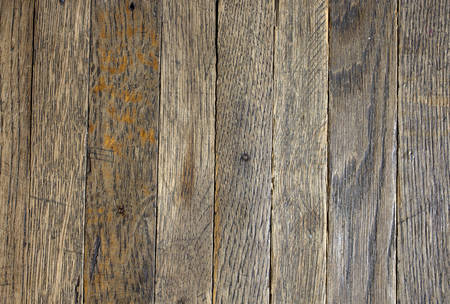 A old dirty brick parquet. Rough surface texture. parquet with stains of paint and dirt. Natural wood texture