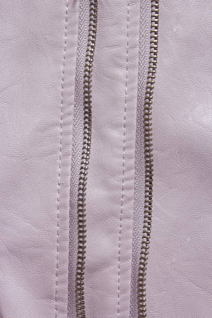 Pink Leather Background. Pink leather background with zipper from the lock. Structured background design leather.