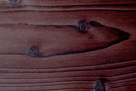 Wooden background of burnt wood. Old wooden background, burnt wood texture, rustic style banner. Burnt wooden Board texture. Burned scratched hardwood surface. Brown color Standard-Bild