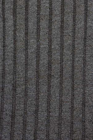 Repeating Machine Knitting Texture of Sweater. Knitted Background. Cable knit background texture in gray tones. Standard-Bild