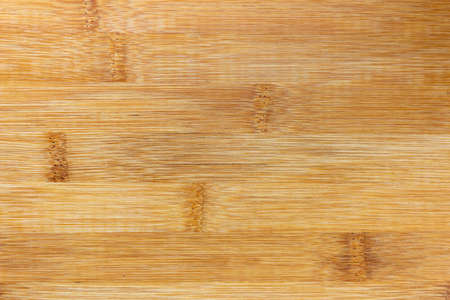 Texture Of Wooden Board Made Of Bamboo. Background Photo Of Texture Of Wooden Chopping Board Made Of Bamboo. Kitchen cutting Board made of bamboo. Board made of natural bamboo wood.