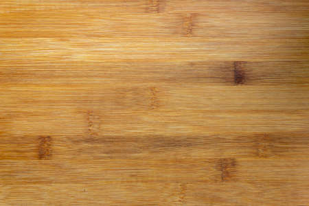 Texture Of Wooden Board Made Of Bamboo. Background Photo Of Texture Of Wooden Chopping Board Made Of Bamboo. Kitchen cutting Board made of bamboo. Board made of natural bamboo wood. Copy space