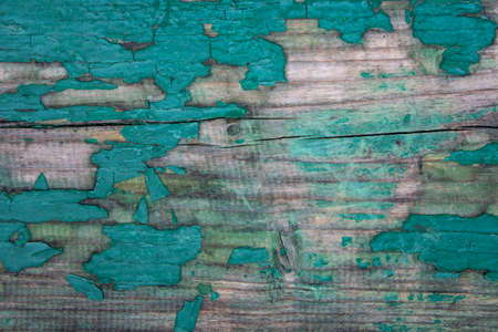 Weathered blue wooden background texture. Shabby wood teal or turquoise green painted. Vintage beach wood backdrop. Shabby decrepit wooden boards. Wood lamellas. Blue rough painted planks surface.