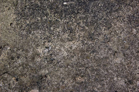 Muddy concrete wall with cracks and black spots. Old and dirty tested wall background. Architecture and construction works. Close-up old weathered concrete texture of the wall. Standard-Bild