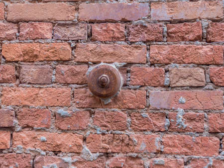 Restoration of historical buildings. Repair of a stone wall.Close-up of an iron support on a brick wall.