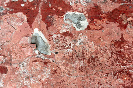 Dark Plaster Wall With Dirty Red Brown Scratched Horizontal Background. Concrete Wall With Peel Rusty Stucco Texture. Retro Vintage Worn Wall Wallpaper. Decay Crack Rough Abstract Banner Surface. 免版税图像