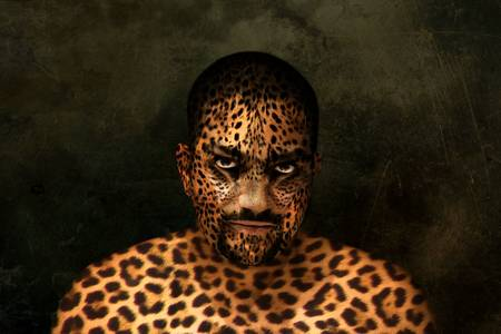 photoshop: A mans portrait esited in Photoshop to look like a tiger.
