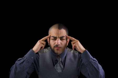 A man holding his head by his fingers, presenting stress and pain. photo