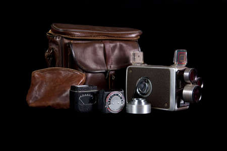 Old camera back to the 1950 with light meter, lens, and original leather case.
