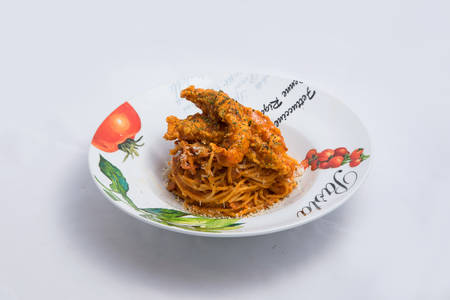 A low contrast Hero shot of chicken curry with pasta noodles in a plate with minimal white background with 60 degree angle from front perspective