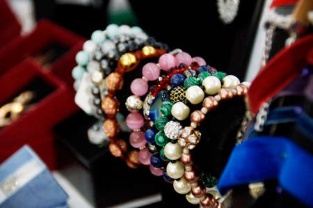 Photo of handmade different bracelets with beads