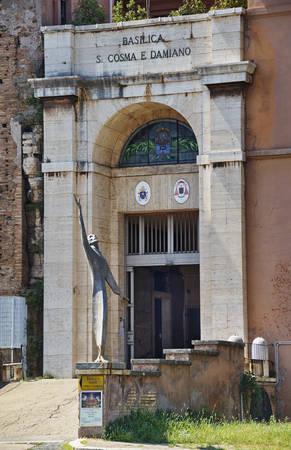 view of entrance to Basilica Santi Cosma e Damiano in Rome