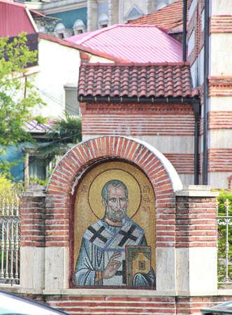 Icon on the facade of the fence of St. Nicolas Church, Stok Fotoğraf
