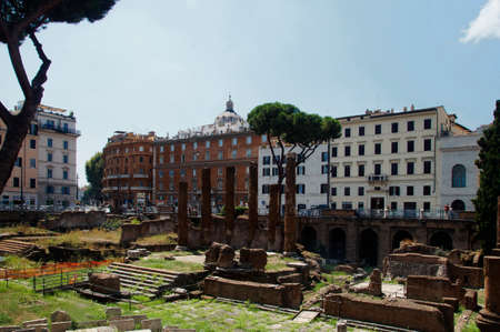 Photo of Archaeological site close to where Julius Caesar was killed. Placed among modern apartment buildings at Largo di Torre Argentina street, Rome, Italy Stok Fotoğraf