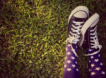 converse: legs relax on the grass