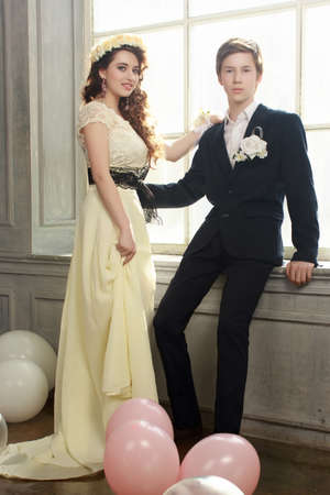 Cute Teenage Prom Couple in beautiful interior