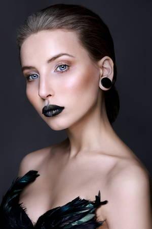 Black lips. Halloween Makeup. Luxury beautiful woman with dark lipstick. Beauty stylish girl