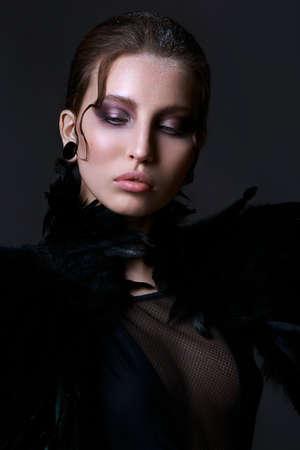 Gothic girl. Halloween Makeup. Luxury beautiful woman with gothic makeup. Beauty stylish vamp girl Stock Photo