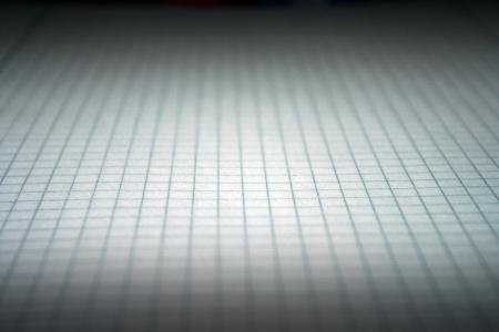 aslant: squared paper darkened as backdrop