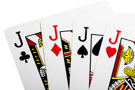 playing with money: Quads of jack for poker over white