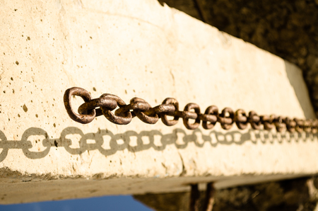 chain on the ruined building photo
