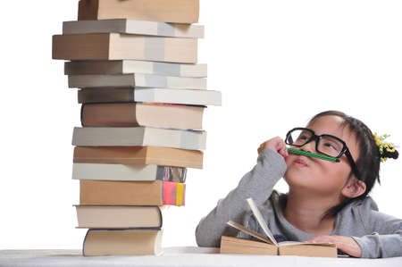 A girl looking at a pile of books with the hope  photo