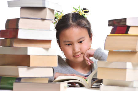 A girl is enjoying her reading time   photo