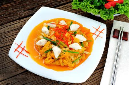 fine wood: Stir fried crabmeat with curry powder Stock Photo
