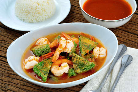 Spicy and sour soup with shrimp and vegetables photo