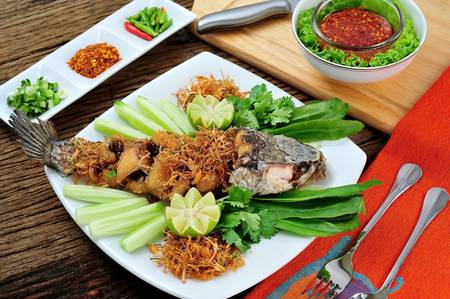 Deep fried snake head fish with spicy sauce photo