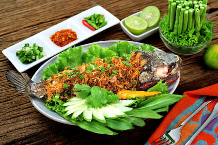 Crispy snake head fish in chili paste and  herb