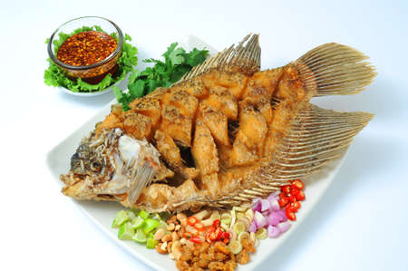 fish meat: Deep fried fish with herbal sauce Stock Photo