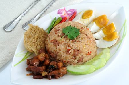 chinese menu: Fried rice with duck yolk,minced pork and chili sauc Stock Photo