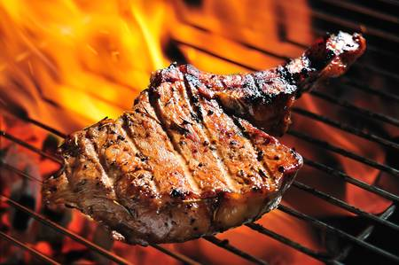 grilled pork steaks on the grill photo