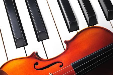 piano closeup: violin and piano keys Stock Photo