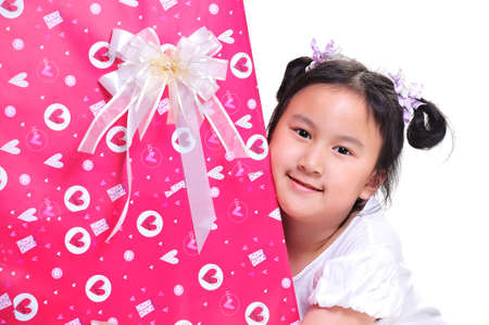 beautiful girl with a gift photo