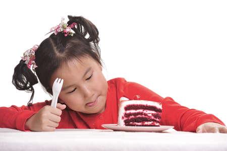 Cute little girl eating cake photo