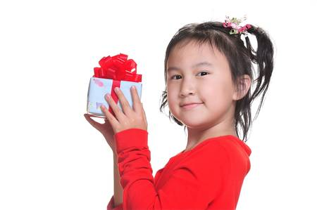 ittle girl with gift box isolated photo